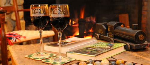 Glasses of wine near the cozy fireplace at Newman's Restaurant in Saluda, NC.
